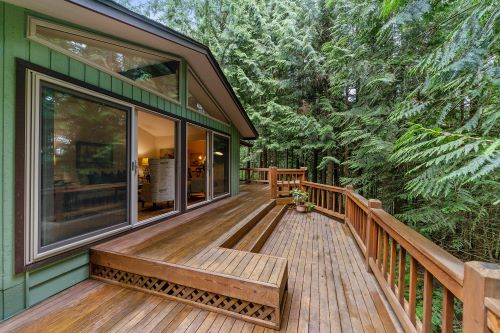 pressure-treated wood deck with sealer on it